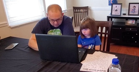 parent helping child with school work